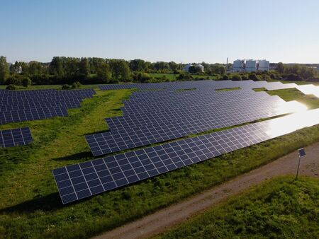 New photovoltaic power plant, sun reflected in solar panels