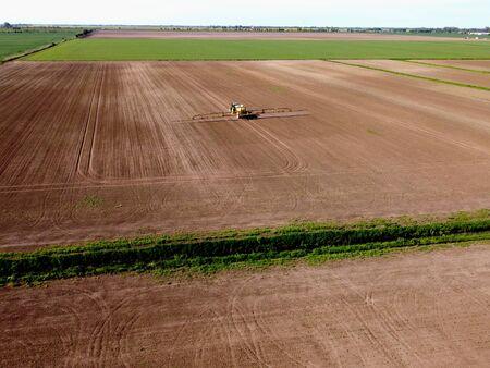 Spraying fields in spring, Zulawy Wislane, Poland