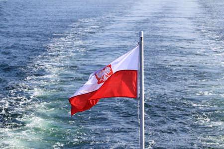 Polish flag waving on the mast of a ship at sea Standard-Bild