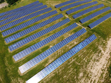 Solar Panels on green field in summer, aerial view, Poland