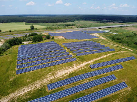 Solar panels on field. Photovoltaic farm in Poland. Renewable energy. Green energy