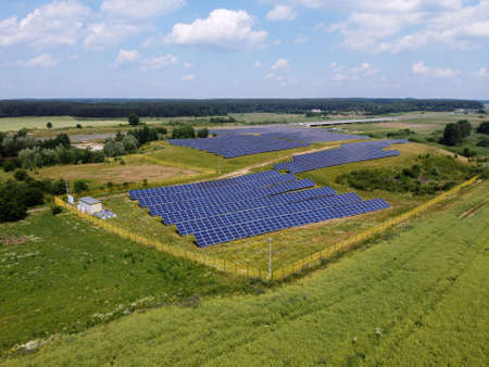 Solar panels on summer field, aerial view of Poland, Europe