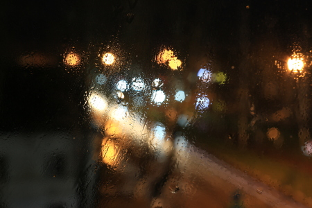 Street lamps photographed through the misted glass with drops of rain Stock Photo