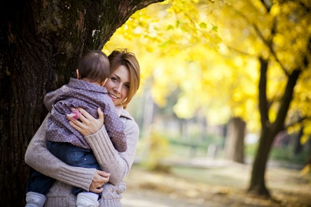 Mother and baby girl in the autumn forest Stock Photo - 15959132