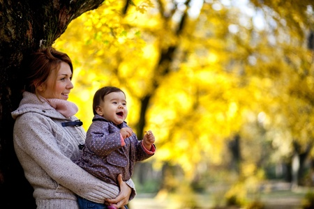 Mother and baby girl in the autumn forest Stock Photo - 15959131