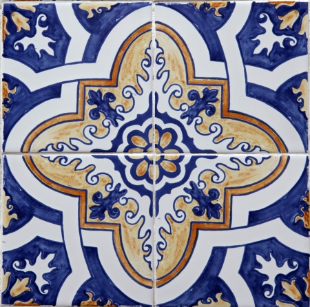 Detail of the traditional tiles from facade of old house in Lisbon, Portugal photo