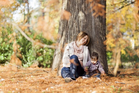 Mother and baby girl in the autumn forest Stock Photo - 15959138