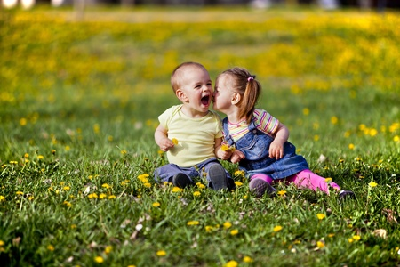 Two kids in the spring field Stock Photo