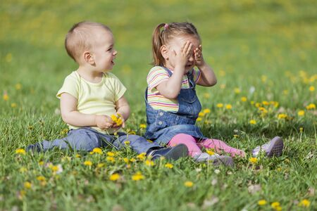 Two kids in the spring field photo