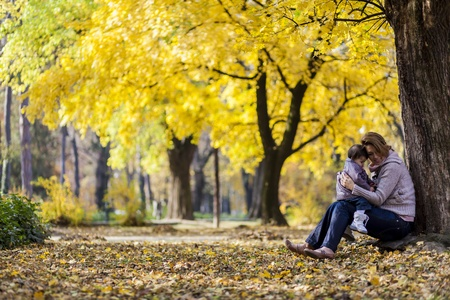 Mother and baby girl in the autumn forest Stock Photo - 16695744