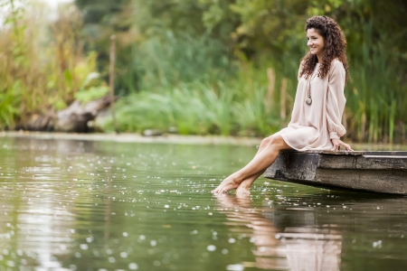 bare body women: Young woman on the calm lake Stock Photo