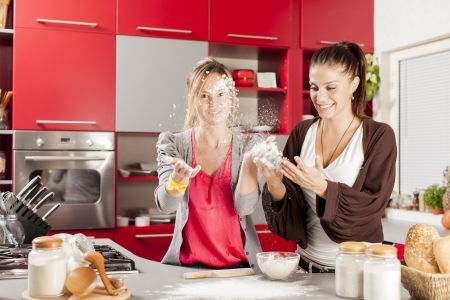 Young women in the kitchen Stock Photo - 17071454