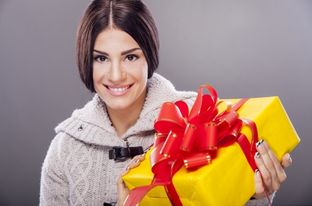 Pretty young woman with gift photo