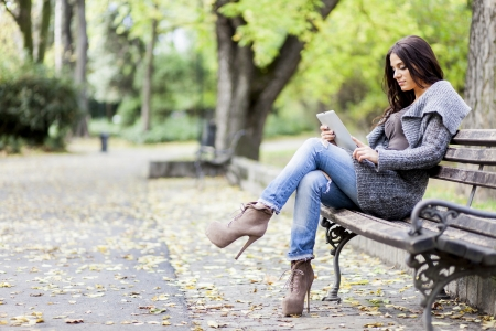 Young girls with tablet in the park Stock Photo