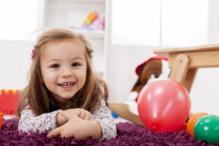 Little girl in the room Stock Photo