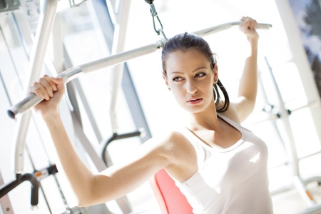 gym clothes: Young woman in the gym Stock Photo