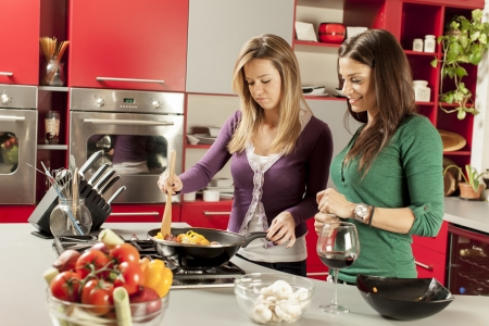 Young women in the kitchen Stock Photo - 17349266