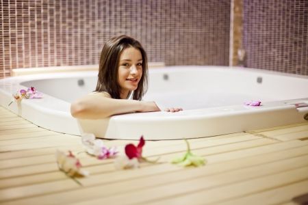 woman bath: Young woman relaxing in the hot tub