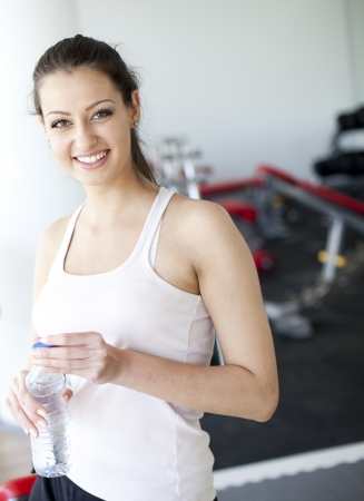 Young woman in the gym photo