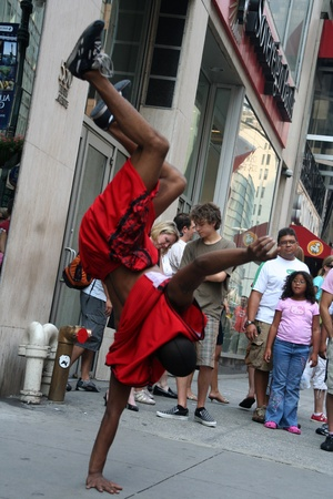 New York, USA, July 13, 2008, Unknown dancer in the street of New York. Street performers in New York only need a permit to perform if they have amplified sound.