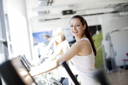 workout gym: Young woman in the gym Stock Photo