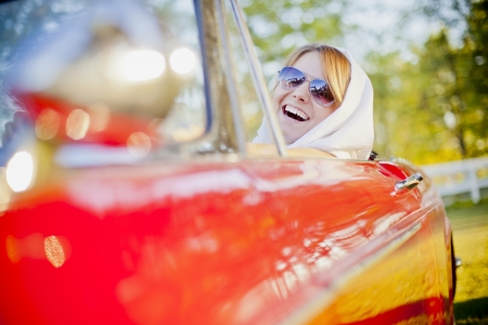Young woman in red cabriolet Stock Photo