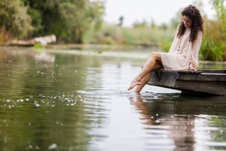 lakes and rivers: Young woman on the calm lake Stock Photo