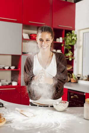Young woman in the kitchen photo