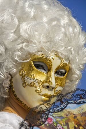 Venice, Italy, February 10, 2013: Unidentified person with traditional Venetian carnival mask in Venice, Italy at February 10, 2013. At 2013 it is held from January 26th to February 12th.