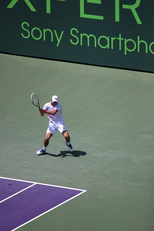 Miami, USA - April 1, 2012: Novak Djokovic at the final match at Sony Ericsson Open in Miami, USA. Djokovic defeating Andy Murray 6-1, 7-6(4) to triumph for the third time at Crandon Park.