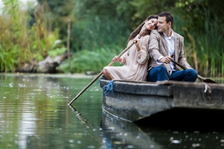 adventure holiday: Loving couple at the calm lake Stock Photo