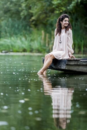 Young woman on the calm lake photo