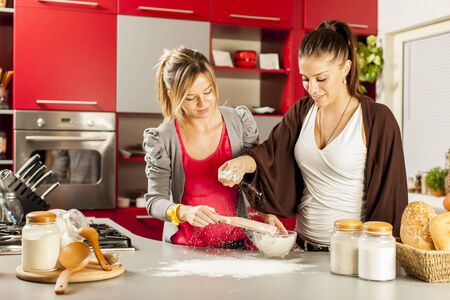Young women in the kitchen photo