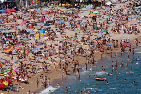 Lloret de Mar, Spain - July 27, 2010: Crowded beach in Lloret de Mar, Spain.