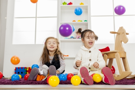 children playing with toys: Kids playing in the room
