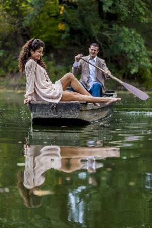 Loving couple at the calm lake photo