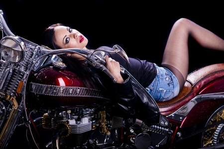 Young woman on the motorcycle photo