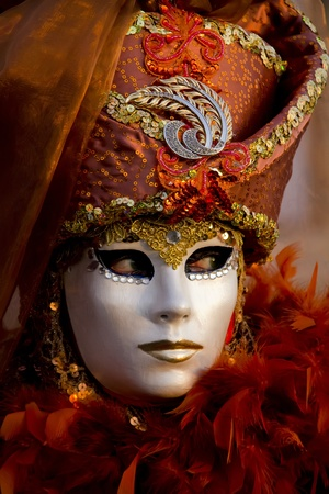 Venice, Italy, February 9, 2013: Unidentified person with traditional Venetian carnival mask in Venice, Italy at February 10, 2013. At 2013 it is held from January 26th to February 12th.