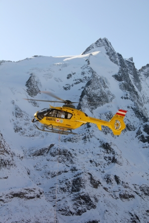 Grossglockner, Austria, October 30, 2011 - Rescue helicopter from Austrian Mountain Rescue Service flying at accident site. At 2001 Rescue Service performed a total of 6508 rescues.