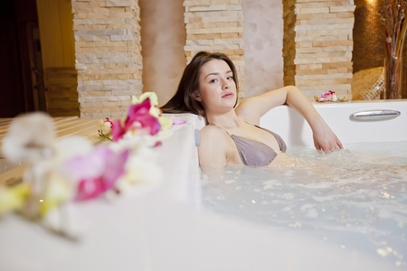 Young woman relaxing in the hot tub photo
