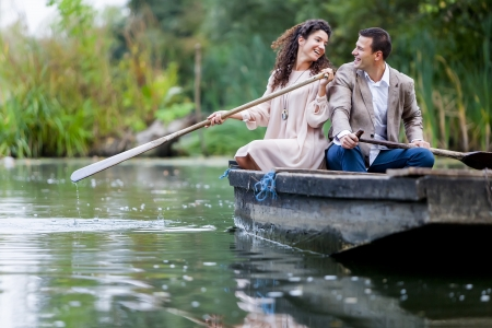 Young couple in the boat photo