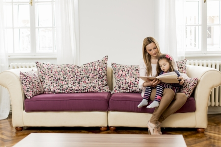 family sofa: Mother and daughter reading in the room