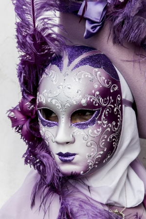 Venice, Italy, February 9, 2013: Unidentified person with traditional Venetian carnival mask in Venice, Italy at February 10, 2013. At 2013 it is held from January 26th to February 12th. Stock Photo - 20289122