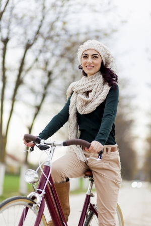 Young woman on the bicycle photo