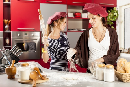 Young women in the kitchen Stock Photo - 20509416