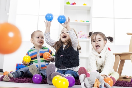 play boy: Kids playing in the room