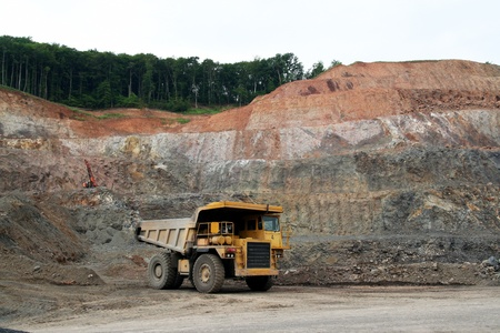 payload: Yellow dumper in the quarry Stock Photo