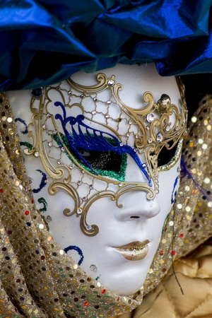 Venice, Italy, February 9, 2013: Unidentified person with traditional Venetian carnival mask in Venice, Italy at February 10, 2013. At 2013 it is held from January 26th to February 12th. Stock Photo - 20527797