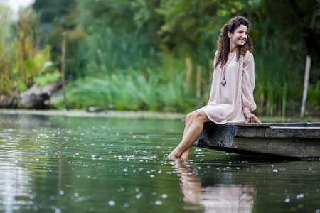 bare foot: Young woman on the calm lake Stock Photo