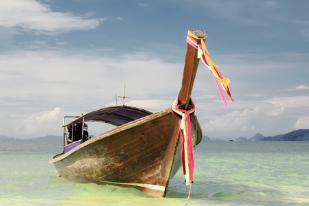 Traditional long tail boat from Thailand photo